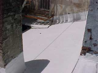 Roof surface is white due to white acrylic coating