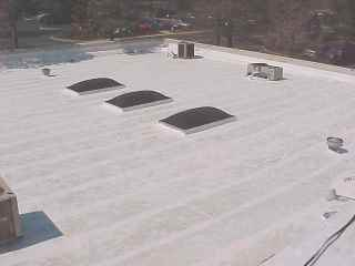 View of roof with equipment, skylite before final coating by Roof Menders