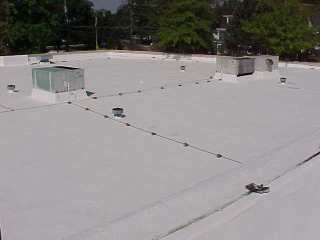 Second coating applied by Roof Menders