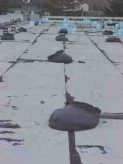 Foundation material is placed on roof in intervals by Roof Menders