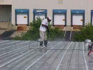 Prepping the roof surface is important for proper application of cool white roof