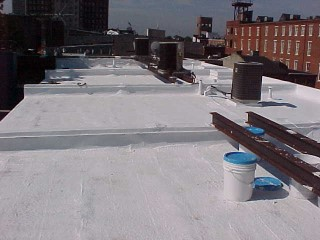 Foam roof with white acrylic applied by Roof Menders