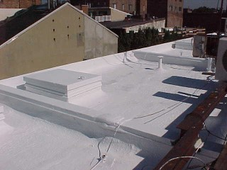 White acrylic applied to hatch cover and connection areas by Roof Menders